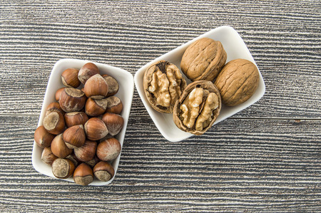 walnut and shelled hazelnut pictures side by side in a separate plate