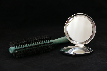 close-up pocket mirror and brush comb,