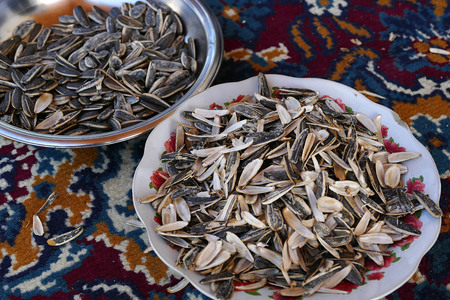 sunflower seeds in plates. People eat sunflower seeds