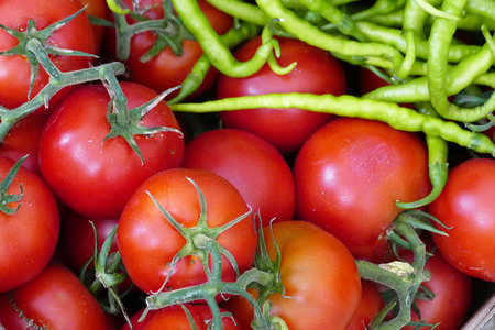 natural tomatoes and fine sweet peppers stand together Banco de Imagens