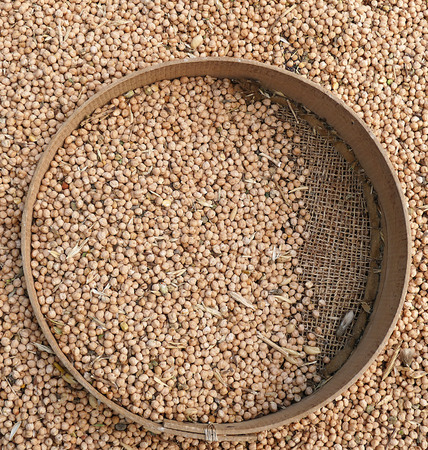 chickpeas and manual sieve,
