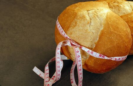 obesity and whole wheat bread, tape measure wrapped in a large bread,