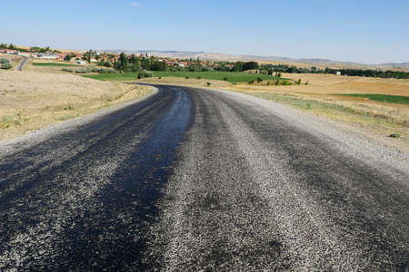 bitumen on the asphalt road, which melts due to the heat in the summer, melted pitch and asphalt road, hot and melted asphalt roads,