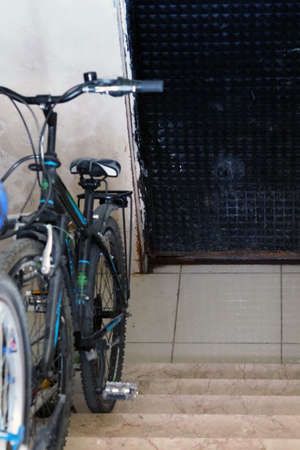 the bicycle standing on the ground floor of the building, Stock fotó
