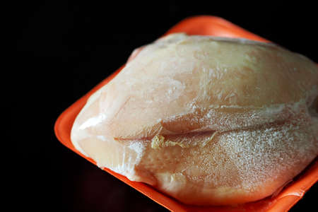 freshly dumped frozen chicken tenderloin, frozen chicken breast, Stock fotó