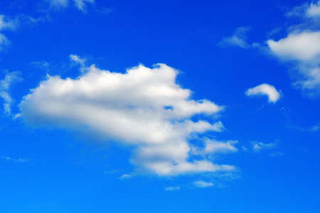 There are few and small clouds in the blue sky,