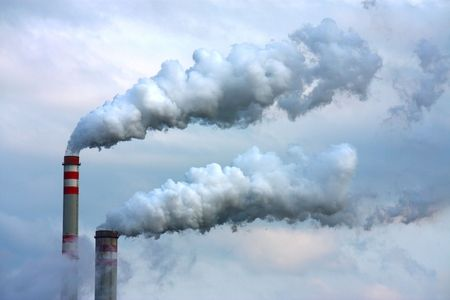 polluted smoke from oil refinery Stock Photo