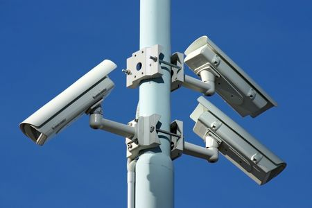 three security cameras on blue background photo