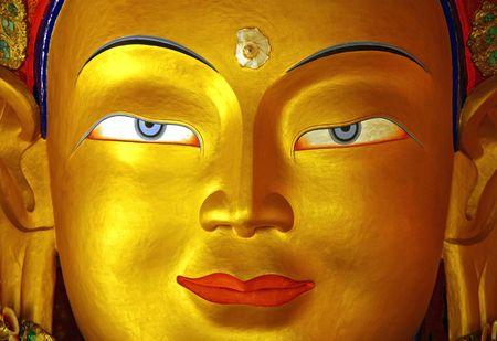 ancient yoga: gold buddha face