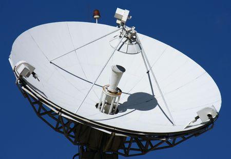 white satellite on blue background photo