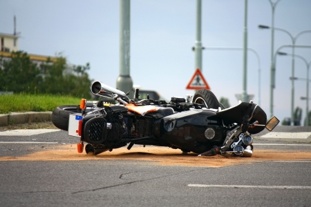 motorcycle accident on the city road photo