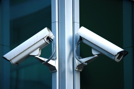 two security cameras on glass facade Stock Photo - 7240827