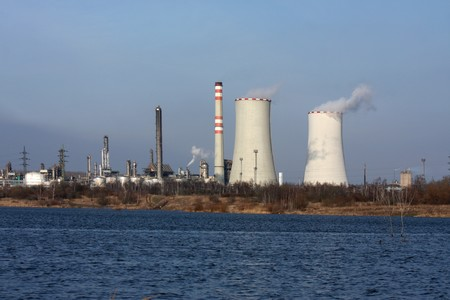 electric generating plant: power plant view and small lake with dark blue water