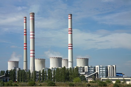 global cooling: coal power plant with chimney and cooling towers