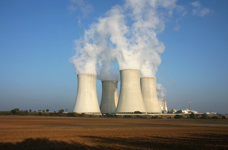 nuclear energy: nuclear power plant and agriculture field Stock Photo