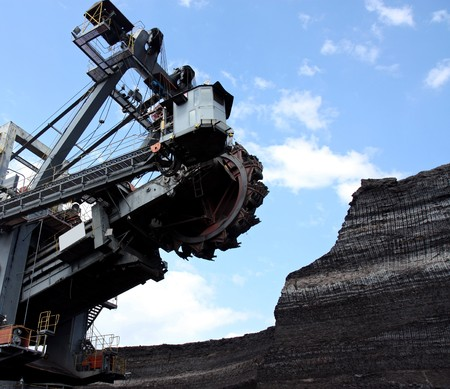 open pit: coal mining with big excavator in action Stock Photo