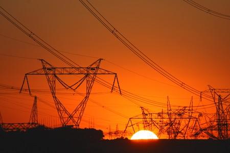 plenty of transmission towers during sunset   photo