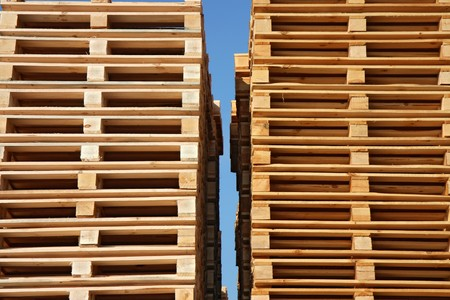 batch of euro: wooden palets up to sky