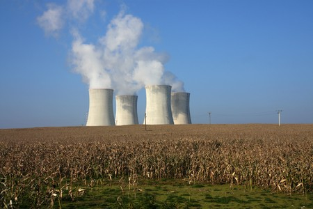 four cooling towers in corn agriculture field Stock Photo - 8247786