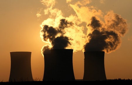 pollution water: cooling towers of nuclear power plant during sunset Stock Photo