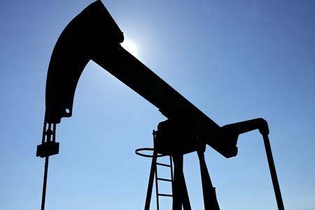 dark oil well against the sun Stock Photo - 8429854