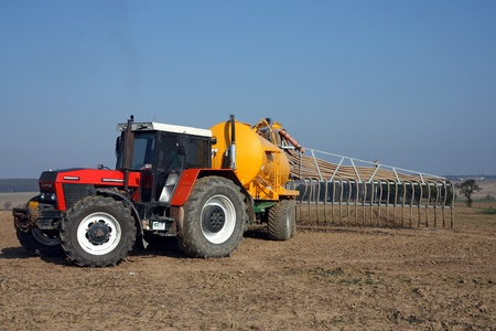 red tractor with yellow sprayer tank