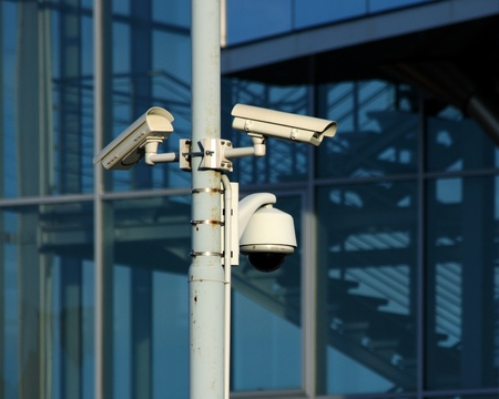 cctv cameras on front of modern glass building Stock Photo - 9351667