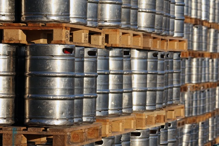 stock of steel kegs on the wooden palettes photo