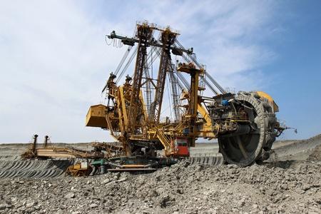 overburden: huge yellow overburden excavator in brown coal mine