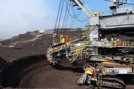 coal mine: gray wheel mining coal excavator