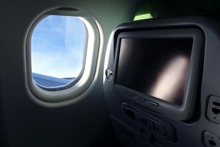 テレビ画面での飛行機の座席の詳細 写真素材