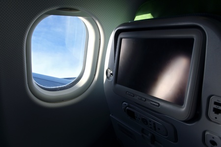 detail of airplane seat with tv screen