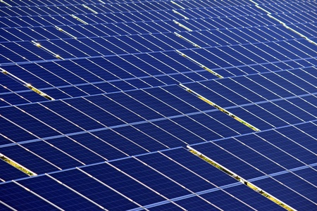 detail of photovoltaic panels under sun light photo