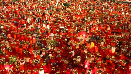 thousens of red candles give the light in night photo