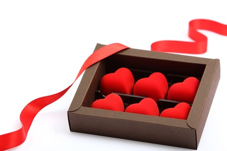 red hearts in brown box on white background photo