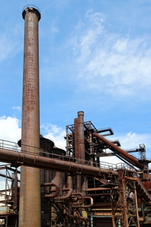 smoke stack: old blast furnace of steel factory Stock Photo