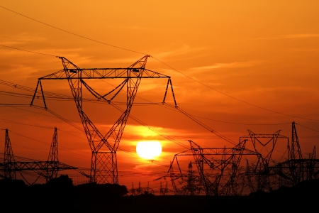 high voltage electric pole during sunset