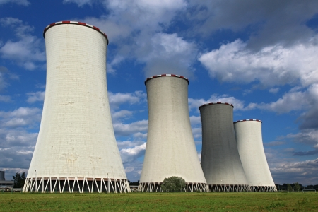 nuclear plant: four coal power plant cooling tower under dramatic sky