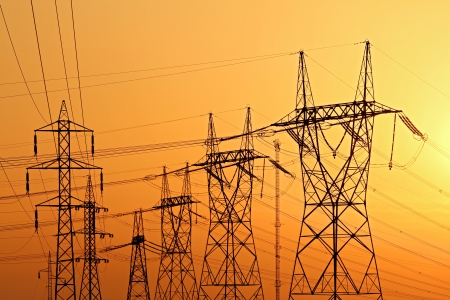high voltage electrical pylons during sunset