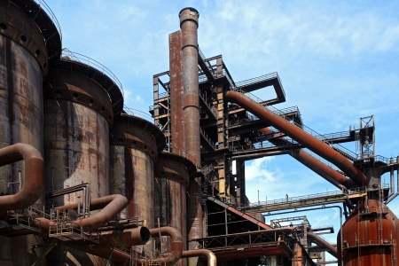 old close blast furnace under sky photo