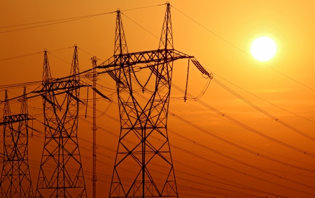 high voltage electrical tower during sunset photo