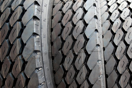 new automobiles: close up new truck black tire