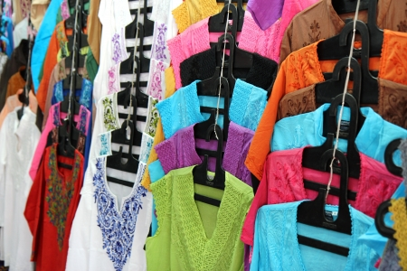 woman closet: indian new fashion clothes on the hangers