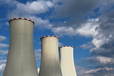 evaporate: three power cooling towers under cloudy sky Stock Photo