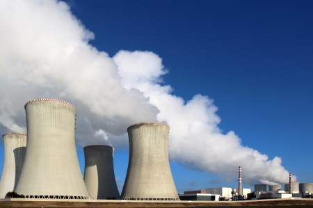 atomic power plant and huge smoke from cooling towers Stock Photo