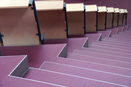 seats with stairs in university hall  photo