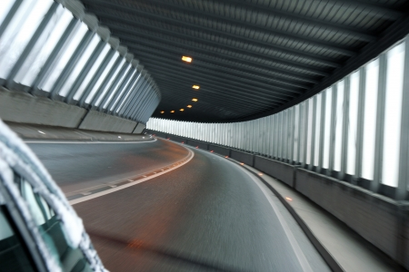 light at the end of the tunnel: detail of car tunnel illuminate with day light Stock Photo