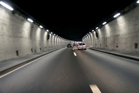 dark tunnel with moving cars