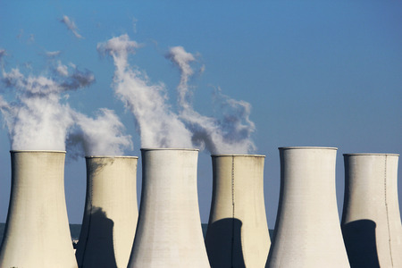 global cooling: six cooling towers of nuclear power plant Stock Photo
