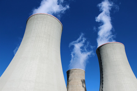 nuclear power plant: three cooling concrete towers of power plant Stock Photo